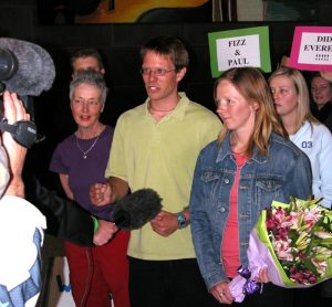 Mary, Paul and Fiona speaking to media on their return to Melbourne airport. Photo Nick Grainger.