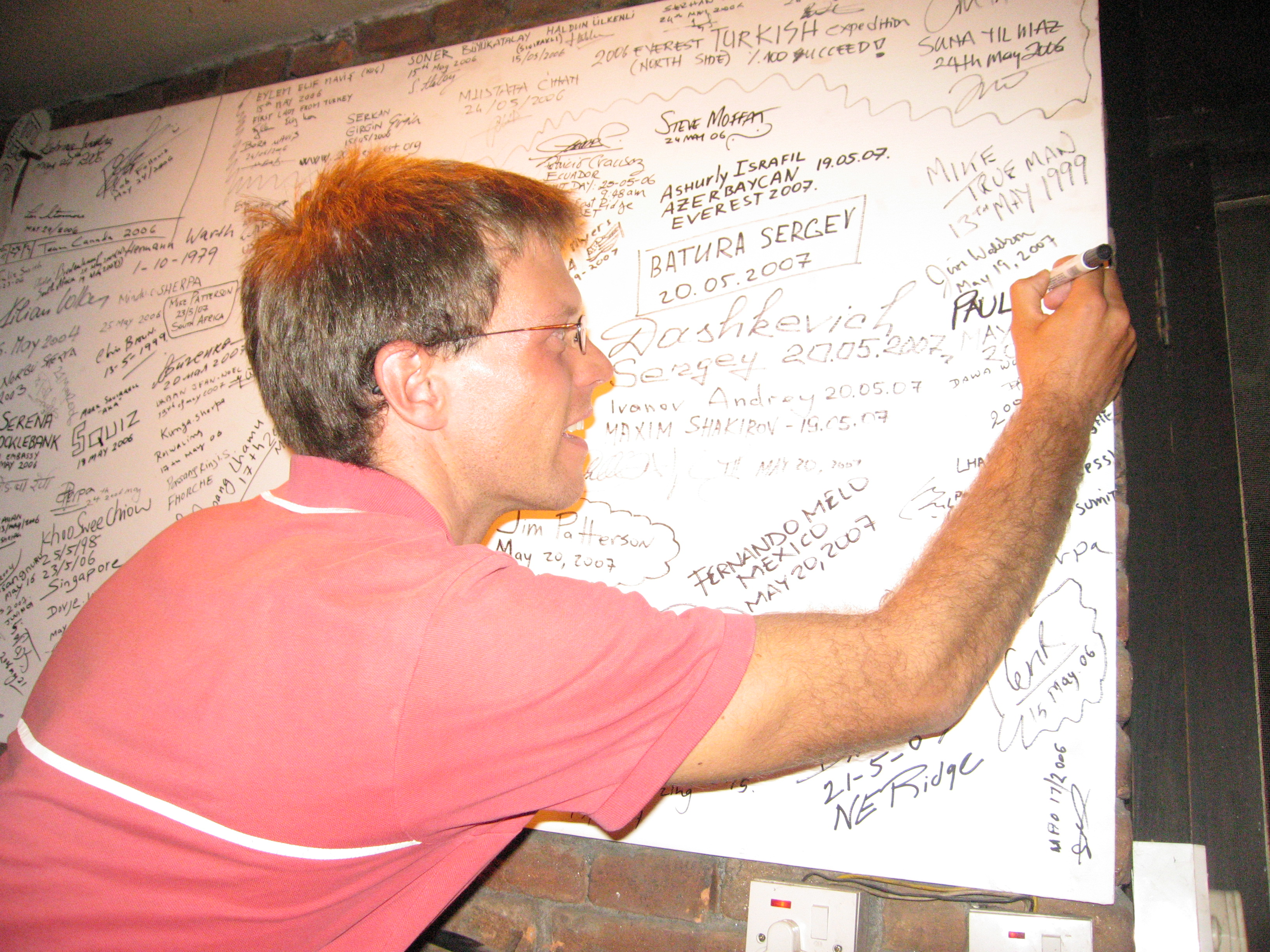 Paul signing his name on the Everest board in Rumdoodle, Kathmandu