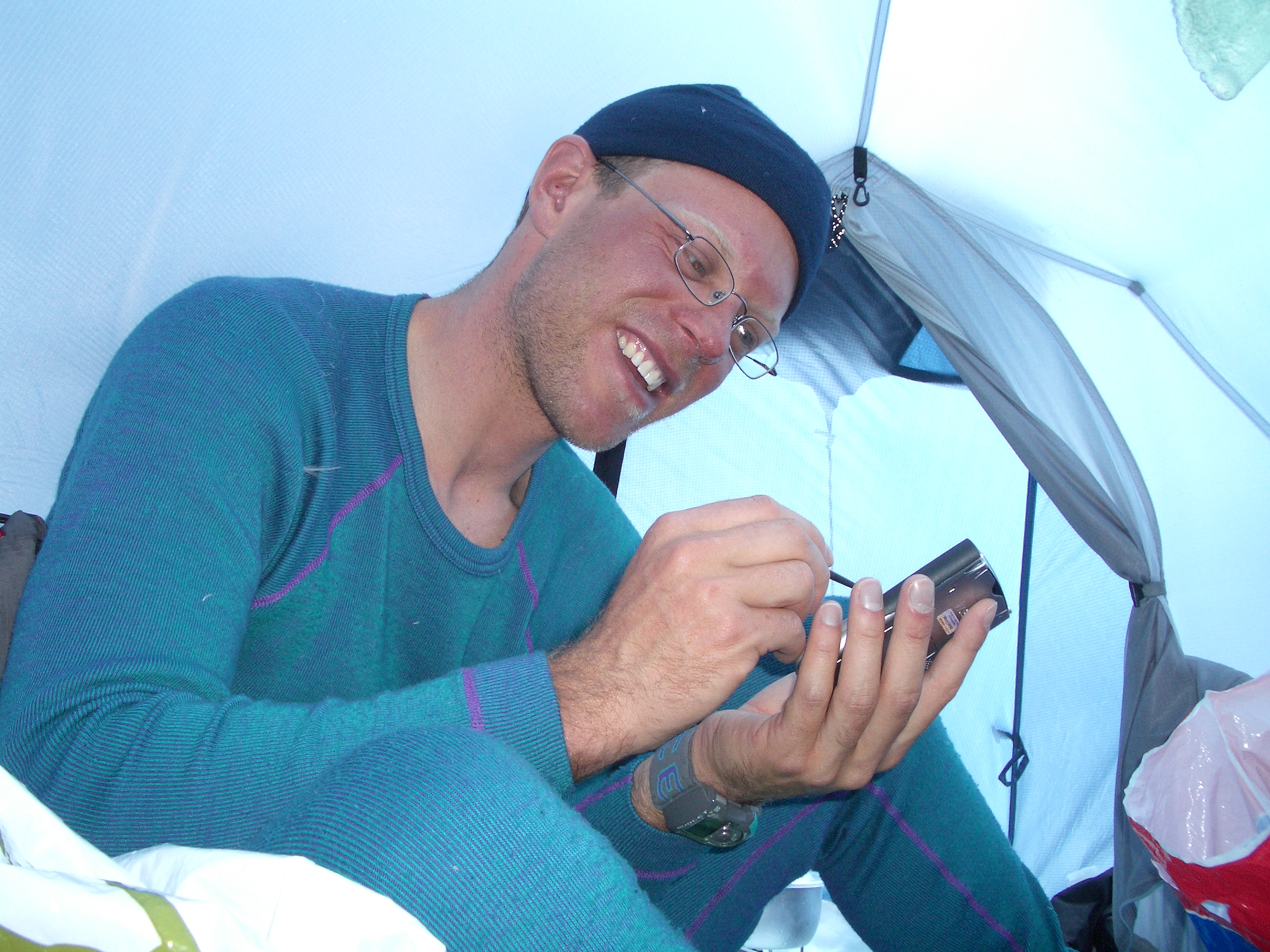 Paul writing a blog post on the PDA while climbing Khan Tengri