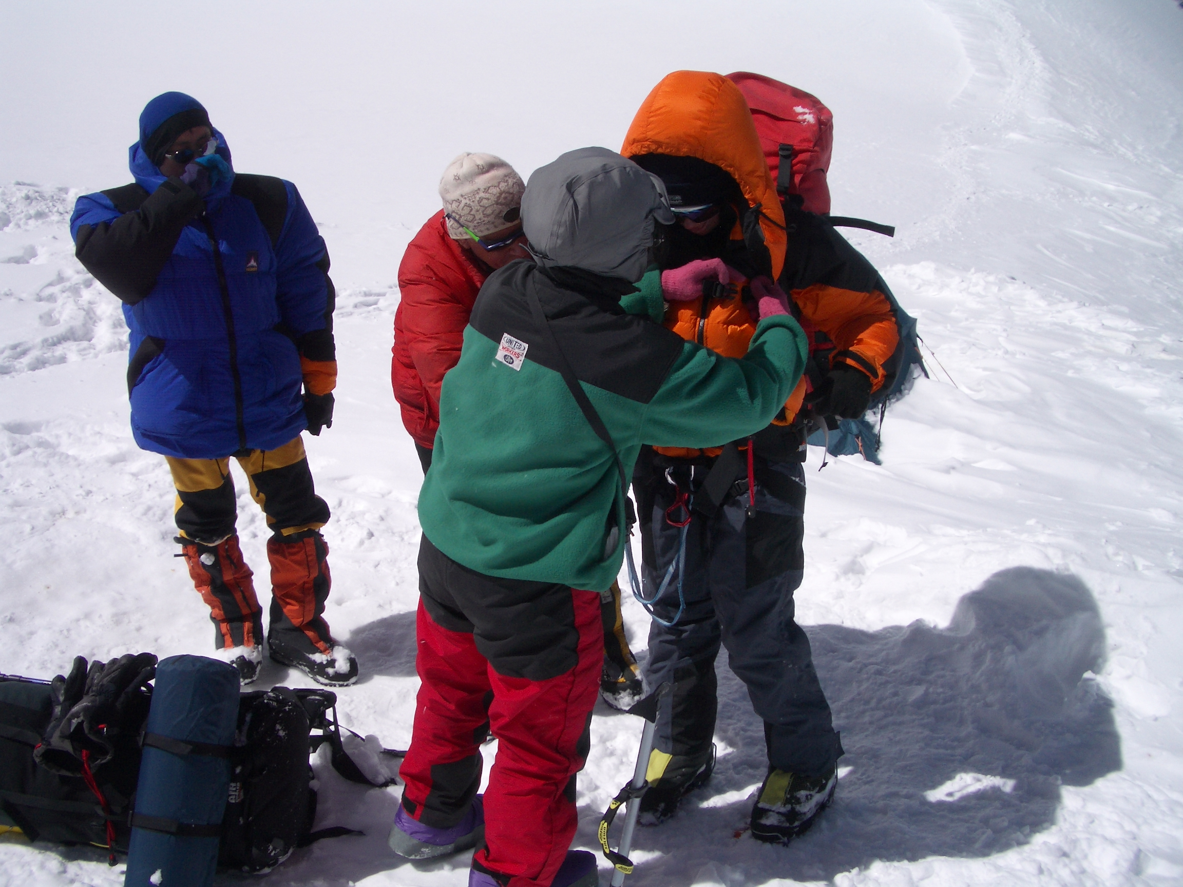The picture is of Fiona being helped this morning by the Koreans at camp 2 into her down gear, climbing harness & backpack. Sore thumbs make it difficult to clip buckles, tighten straps etc. The generosity of the people here continues to amaze, with the Koreans in particular not stopping at anything. We gave them all our left over gas and food at camp 2.
