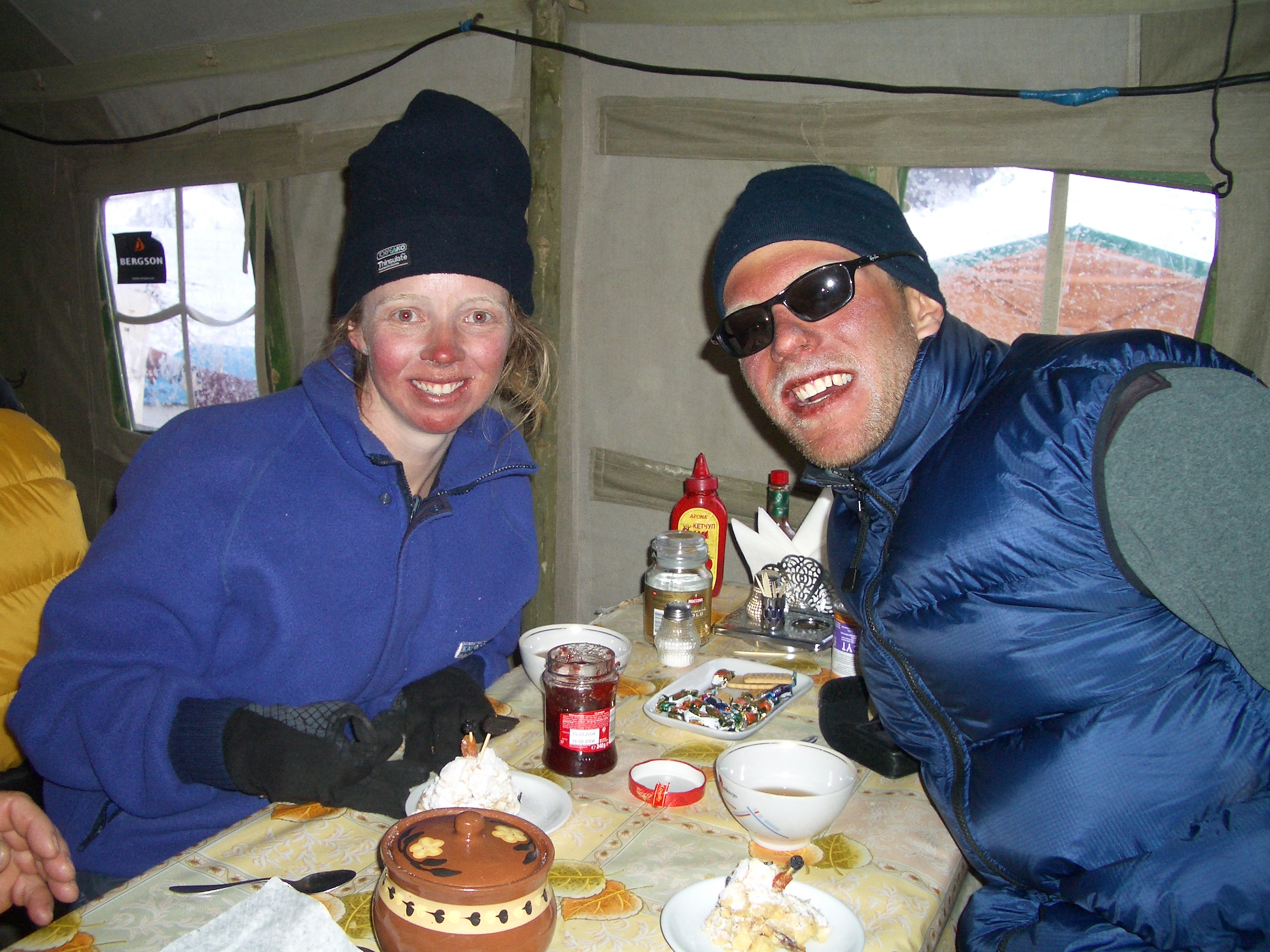Fiona and Paul - sunburnt, frostbitten, tired and hungry. But glad to back at basecamp, Khan Tengri