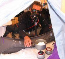 Dennis melting snow at camp 3