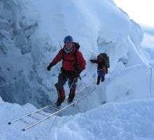 Paul and Dasona on another ladder in the Everest Icefall