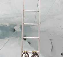 Paul looking down a crevasse in the Everest icefall