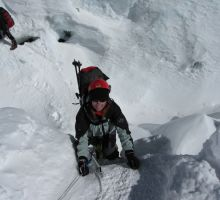 Fiona climbing up one of the vertical ladders in the Everest icefall