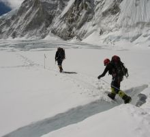 Fiona stepping across a small crevasse on Everest
