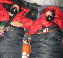 Paul and Fiona using oxygen for the first time to sleep with at camp 3