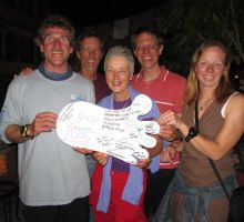 "Jim, Dennis, Mary, Paul and Fiona - holding the ""Big Foot"" we've all signed to commemorate our trip"
