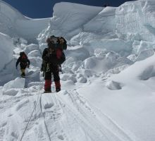 Climbers heading up through the icefall