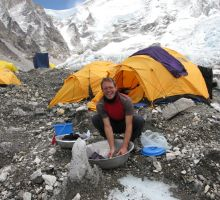 Paul washing clothes at Everest basecamp