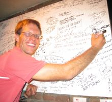 Paul - very happy to be signing his name on the Everest board in Rumdoodle, Kathmandu
