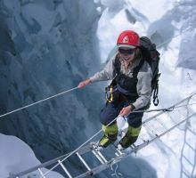 Fiona crossing the first ladder in the icefall on Everest
