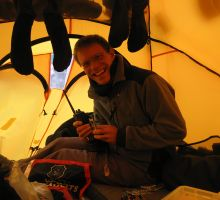 Paul in his tent, drying socks and posting a blog update