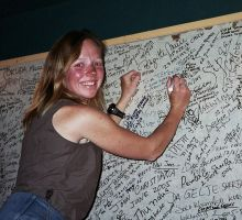 Fiona signs the summiteers board (just nearby is Brigette Muir's signature - the 1st Australian woman to summit)