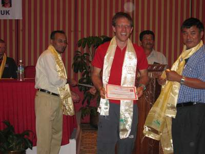 Paul receiving his summiter's certificate last night. On the left is the official government representative and on his right is Ang Shiring, the owner of Asian Trekking. Photo Fiona Adler.