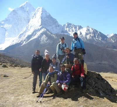 Halfway to Dugla with Ama Dablam behind. From left to right: Cas, Fiona, Denise, Marg, Pemba, Beck, Liz, Julia, and Ang Nima. Photo: a farmer from Yorkshire, UK!