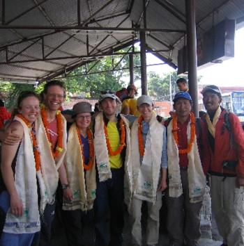 Fiona, Paul, Meagan, Attila, Reni, Ptemba and Lhakpa at the arrivals lounge (!) in Kathmandu. We were greeted with kata scarves and flowers by Asian Trekking.