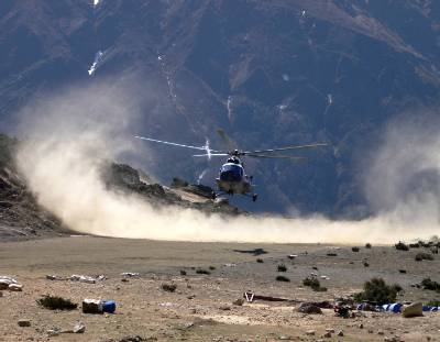 Watching a helicopter land above Namche. Photo Cassra Schahbasi.