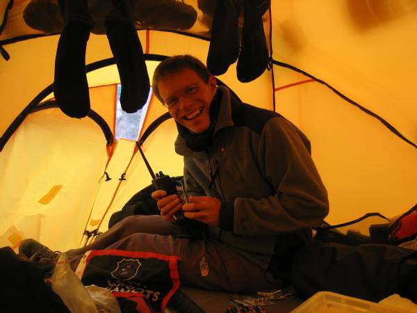 Paul gets the batteries ready for the radio. We have a fresh set for up to C3 and then a new set for the South Col and higher. Photo Fiona Adler