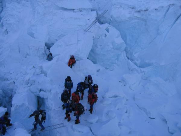 Sherpas wait while a ladder is being fixed after a collapse in the icefall this morning. The area was very unstable. Photo Paul Adler