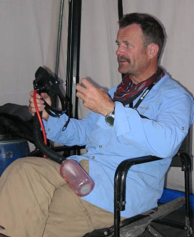 Ted Atkins demonstrates the TopOut oxygen mask that he designed and that I am using. Photo Paul Adler.